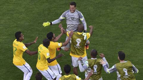 Keeper Julio Caesar celebrates with with teammates after saving the decisive penalty by Gonzalo Jara. Fans in the Estadio Mineirao were ecstatic as the home team made it through to the quarters. (Source: Reuters)