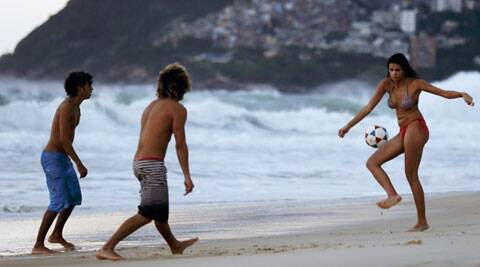 People play football at Ipanema beach in Rio de Janeiro. Rio is one of the most expensive cities in an astoundingly expensive Brazil (Source: Reuters)