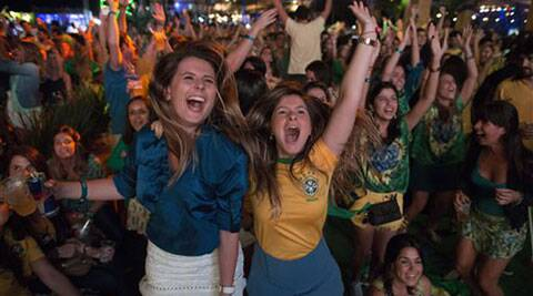 Brazilian fans erupt after their team score a goal against Croatia. (Source: AP photo)