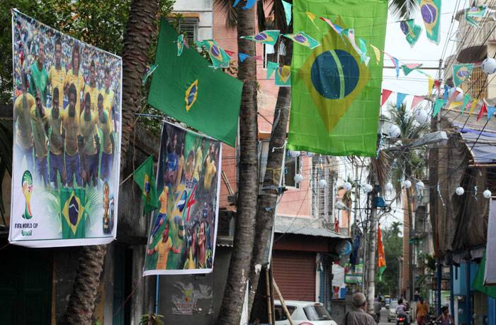 Roaming across the streets of Kolkata, one is bound to wonder whether they are in India or Brazil. Almost every nook and corner of the city is adorned with flags and pictures of Brazil at the World Cup.  (Source: IE Photo by Partha Paul)