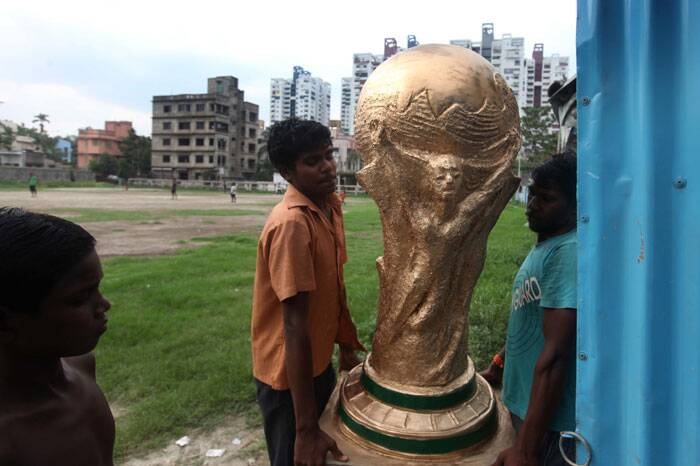 Time and again, Kolkata has proven to be most football-obsessed city of India, and this year's World Cup is no exception. These artists created an astounding clay replica of the FIFA World Cup for a local football club.  (Source: IE Photo by Partha Paul)