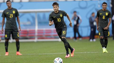 Brazil's Neymar (C)  runs for the ball during an official training session ahead of their Group A match against Croatia at the Itaquerao Stadium in Sao Paulo. (Source: AP)