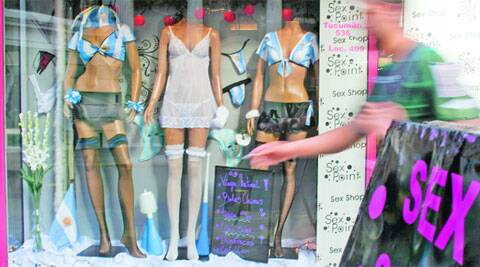 A man walks by a sex shop displaying mannequins sporting Argentina's national soccer team jersey in Buenos Aires (Source: Reuters)