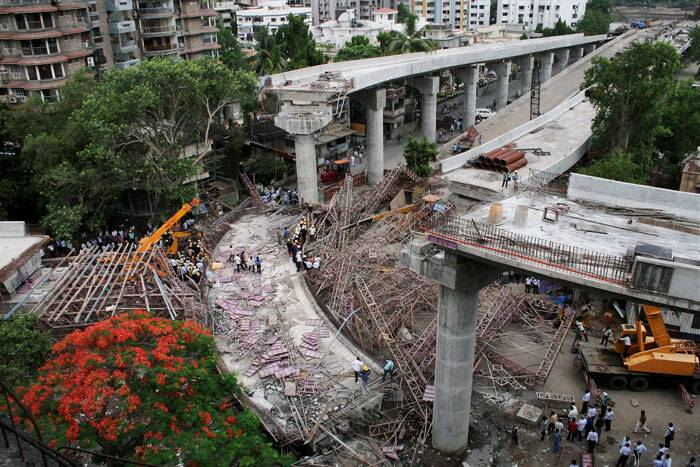 Surat Mayor Niranjan Jajmera said that they feared five more labourers were trapped inside the rubble and operation was on to rescue them. <br /><br /> The site of collapsed bridge. (PTI)