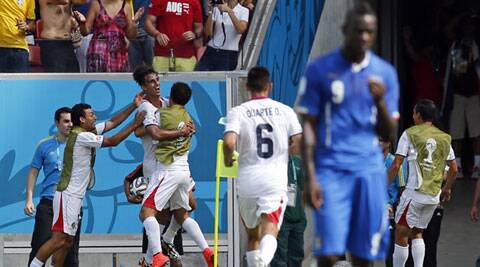 Costa Rica's Bryan Ruiz (second left) celebrates after scoring his team's first goal as a visibly distraught Balotelli walks away. Source: AP)