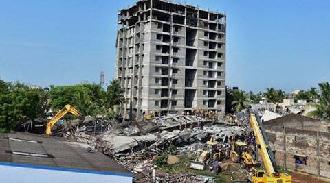 Bulldozers try to clear the debris of the collapsed eleven-storey building near suburban Porur in Chennai on Sunday. (Source: PTI photo)