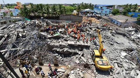 Rescuers search for workers believed buried in the rubble of a building that collapsed on the outskirts of Chennai. (Source: PTI photo)