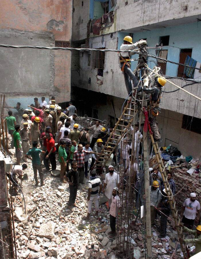 Twelve persons were rescued from under the debris and rushed to hospitals, police said. (Source: PTI)