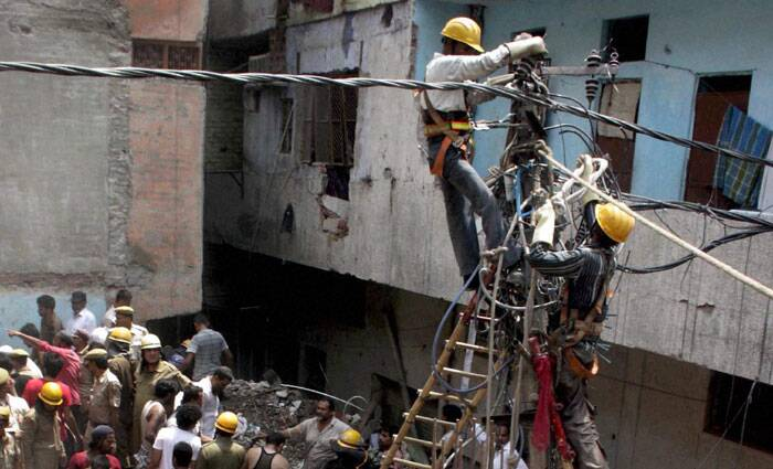 At least 10 persons were killed and several others injured when a four-storey building collapsed in Inderlok area in North Delhi on Saturday. (Source: PTI)