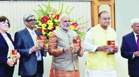 Prime Minister Narendra Modi and Union Minister for Finance, Corporate Affairs and Defence Arun Jaitley with Jessica Mathews (left), President of the Carnegie Endowment for International Peace, and editors Bibek Debroy (second left) and Ashley Tellis (right) at the book release function in New Delhi on Sunday. (Source: PTI)