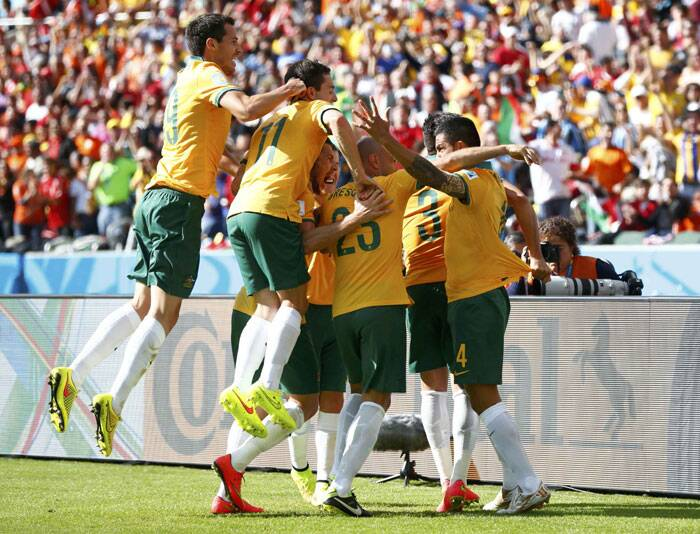 Australian players  celebrate after Tim Cahill (R) scored the equalizer in the 21st minute of the match. (AP