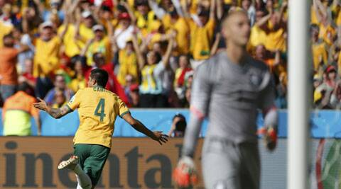 Australia's Tim Cahill celebrates after scoring a goal, as goalkeeper Jasper Cillessen of the Netherlands walks away (Source: Reuters)