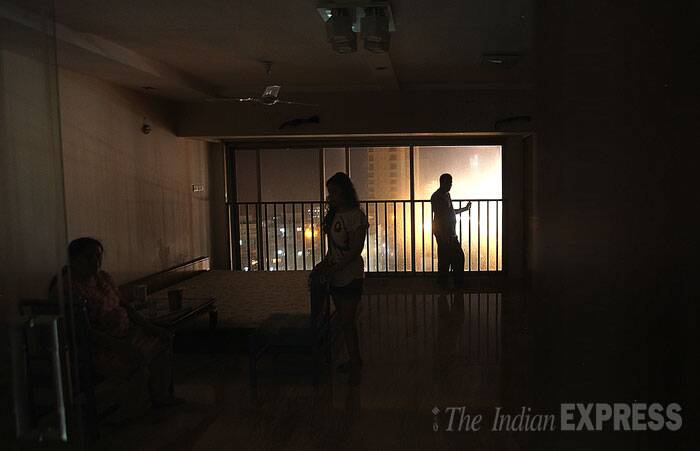 A family is seen spending time in the dark as the electricity supply was stopped for the Campa Cola Compound. (Source: Express photo by Pradip Das)