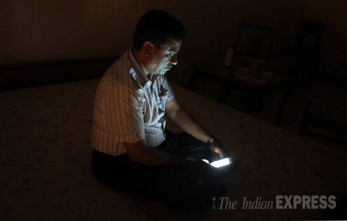 Fighting resistance from residents of Campa Cola Compound in Worli, the Brihanmumbai Municipal Corporation (BMC) disconnected electricity connection for 55 illegal flats, gas connections for around 14 flats and water supply for three flats of the seven buildings in the compound. <br /> Seen here is  a  resident of Campa Cola society sitting in the dark after their basic amenities were cut off in Mumbai. (Source: Express photo by Pradip Das)
