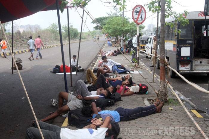 Candidates are seen resting after their fitness exam. (Source: Express photo by Deepak Joshi)