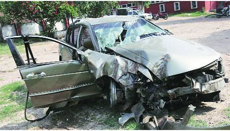 The damaged car outside Sector 26 police station Saturday. (Source: Express photos)