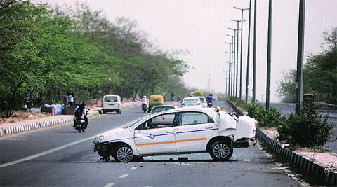 A car blocks Aruna Asaf Ali Road after an accident in the capital on Sunday. (Express photo by Ravi Kanojia)