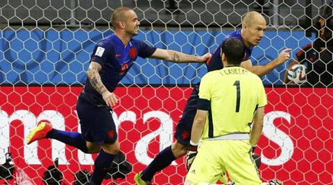 Spain's Iker Casillas looks on as Arjen Robben (centre) and Wesley Sneijder celebrate a goal during a Group B match in Salvador on Friday. (Source: Reuters)