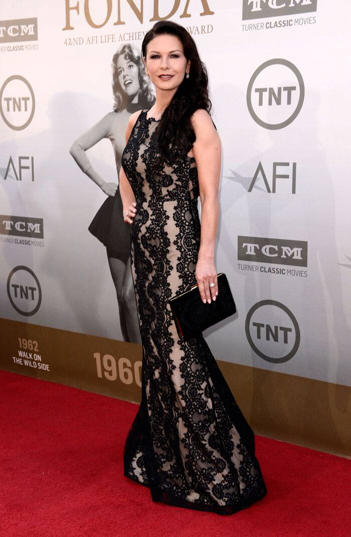 The 'Mask of Zorro' actress was stunning as ever in a floor-length black lace gown with a matching clutch as she posed for pictures on the red carpet. (Source: AP)
