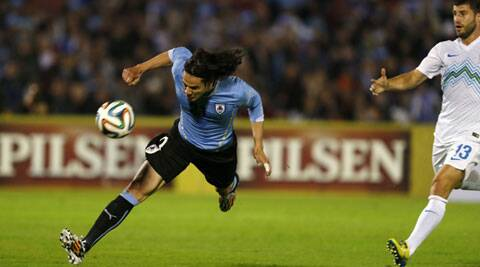 Uruguay's Edinson Cavani heads the ball to score a goal against Slovenia during their friendly match in Montevideo, June 4, 2014. (Source: Reuters)