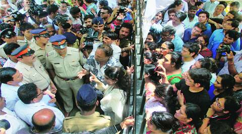 Residents of Campa Cola Society block the entry of civic officials on Saturday. (Source: Express photo by Amit Chakravarty)