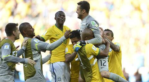 Brazilian players react after winning their Round of 16 match against Chile on penalties. It was after the two teams couldn't break the stalemate during the extra-time (Source: AP)