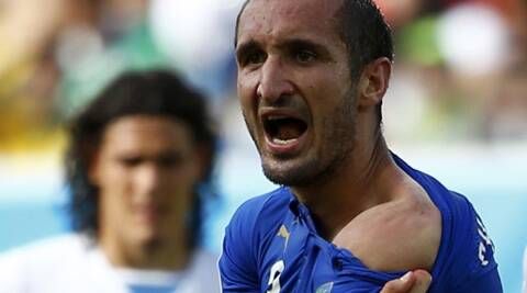 Suarez was slapped a nine-match ban after for biting Chiellini in their final Group D match in Natal on Tuesday. (Source: Reuters)