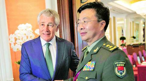 US Defence Secretary Chuck Hagel (left) shakes hands with Lieutenant-General Wang Guanzhong, deputy chief of the general staff of the People's Liberation Army, in Singapore Saturday. REUTERS