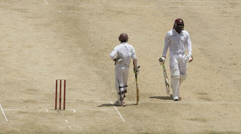 Playing his 100th Test match, Chris Gayle (R) scored a patient 64 at the top of the order (Source: AP)