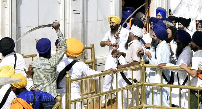 The situation took an ugly turn when SAD (Amritsar) head Simranjeet Singh Mann and supporters allegedly tried to deliver a message from the rostrum of the Akal Takht, Amritsar police said. (Source: Express photo by Rana Simranjit Singh)