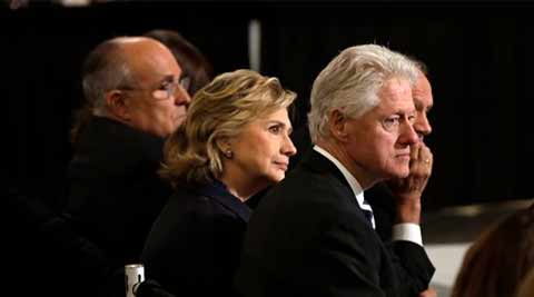 Former New York Mayor Rudolph Giuliani, left, Hillary Rodham Clinton, and former President Bill Clinton. (Source: AP)