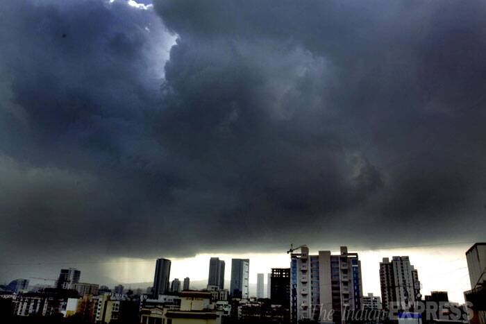Dark rain clouds cover the sky over Mumbai on Friday.(Source: Express photo by Vasant Prabhu)