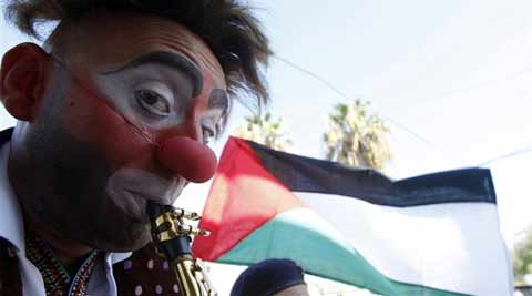 Clay, along with three other clowns - another American, a Chilean and Lebanese - juggled, played instruments and acted like buffoons. (Source: Reuters)
