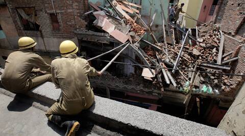 Operations to remove the debris are on. (Source: Express photo by Ravi Kanojia)