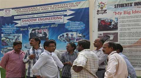 College staff working at VNR Vignana Jyothi Institute of Engineering and Technology, gather around in the college premises on the outskirts of Hyderabad. (Source: AP)