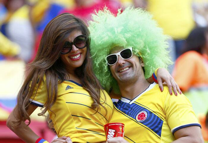 A la Valderrama: A Colombian fan sports a wig resembling former star player Carlos Valderamma. Colombia booked their last 16 spot with a 2-1 win over Cote d'Ivorie. (Source: Reuters)