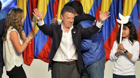 President Juan Manuel Santos celebrates his victory in the presidential runoff at his campaign headquarters in Bogota, Colombia. (AP)