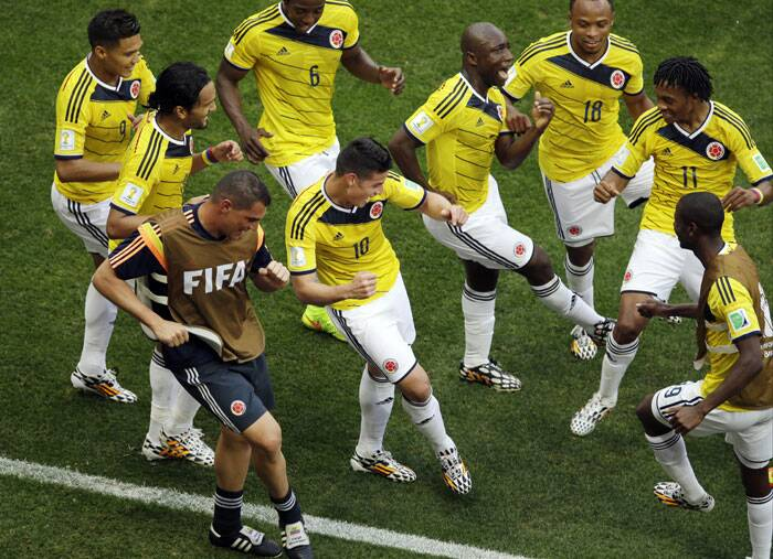 Colombian players celebrate James Rodriguez's first goal.  (Source: AP)