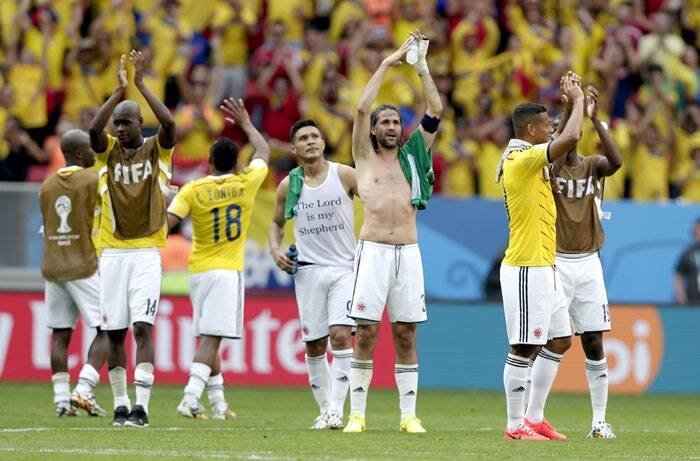 Colombian players celebrate their side's emphatic victory over a strong Ivory Coast side. Colombia won 2-1. (Source: AP)