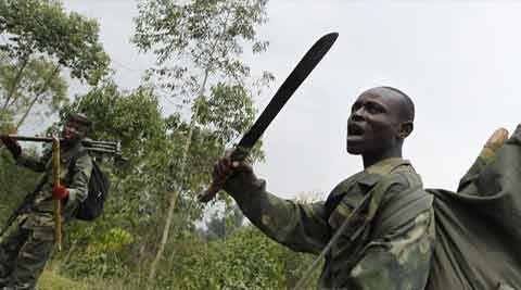 A Congolese armed forces soldier brandishing a machete while moving to new positions in the battle against the M23 rebels in Kibati, outside Goma in the eastern Democratic Republic of Congo. (Source: Reuters)