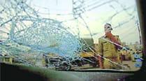 After violence, burnt buses and smashed glass line Dadri's desertedstreets