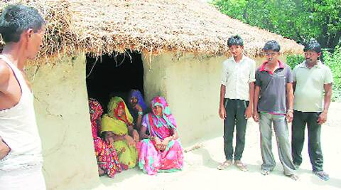 The five-year-old's mother with family and neighbours at their home, the only Dalit house in Babullapur . Source:  Amardeep