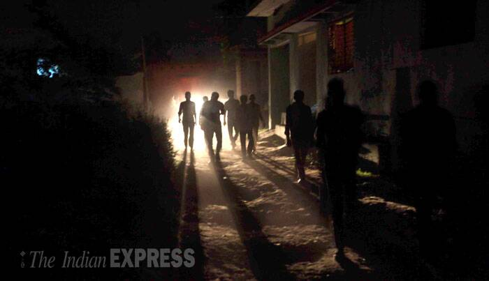 A senior police officer claimed that prima facie it appeared to be a case of suicide. <br /> Villagers leave for the cremation ground with the body of the victim on Thursday night. (Source: Express photo by Oinam Anand)