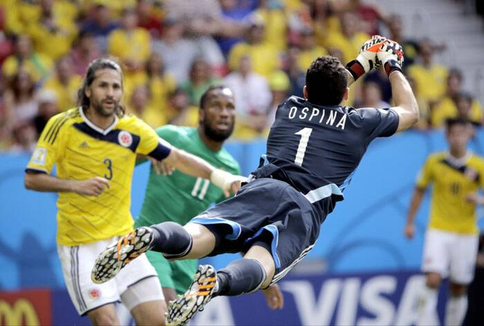 Colombia's goalkeeper David Ospina punches the ball away from the goal. (Source: AP)
