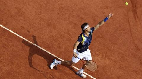 Spain's David Ferrer serves against Serbia's Dusan Lajovic during their pre-quarterfinal match on Monday. Ferrer won 6-3, 6-3, 6-7 (5), 6-1 (Source: AP)