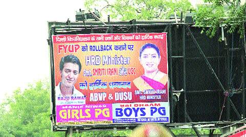 A poster thanking the HRD Minister for rolling back FYUP seen on North Campus