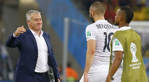 France's coach Didier Deschamps smiles at player Karim Benzema (C) after their World Cup contest (Source: Reuters)