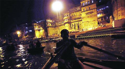 Rowing by the ghats in Varanasi.  ( Source: Express photo by Neeraj Priyadarshi )