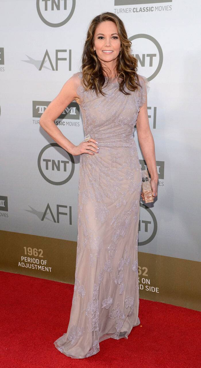 'Unfaithful' actress Diane Lane was stunning in a soft coloured shimmery gown with a metallic clutch. (Source: Reuters)