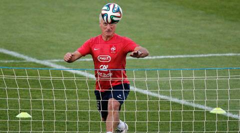 France's head coach Didier Deschamps plays tennis-ball during a training session at the Santa Cruz stadium (Source: AP)